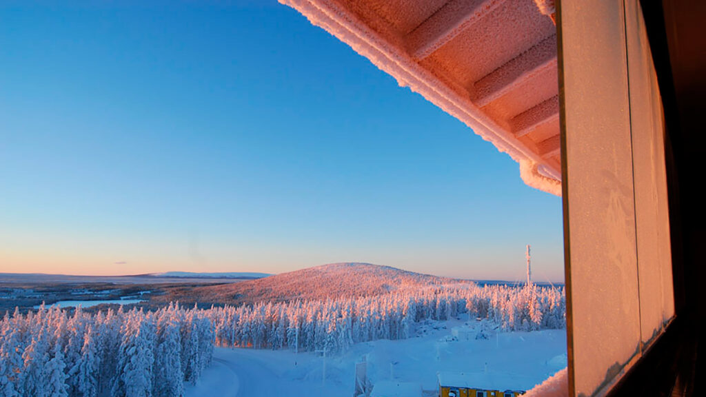 The view from Levi Chalet apartments to the fells of snowy Lapland.