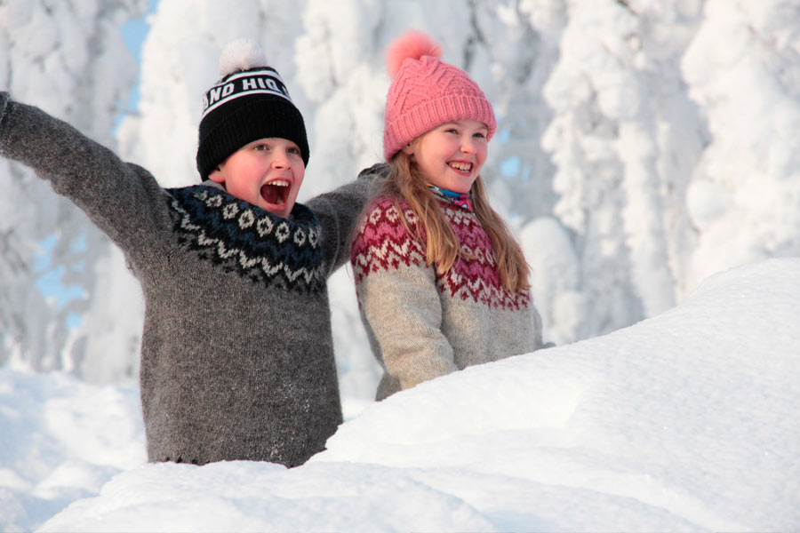 Children enjoying snow in Levi, Finland.